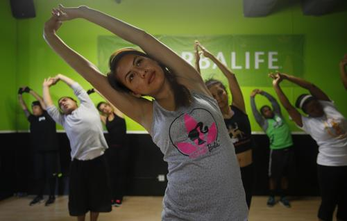 Fitness enthusiasts exercise at a Torrance gym operated by Herbalife distributors January 29, 2013.