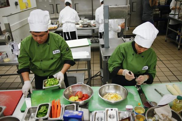 Los Angeles students work on their dishes in a competition to come up with healthful school menu items. Some health professionals have been learning more about cooking as well so they can better advise patients on nutrition.