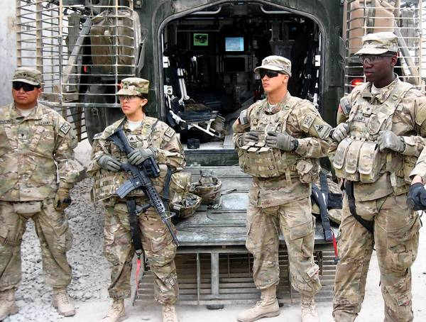 Sgt. Diana Garcia attends a briefing before going on a mission with members of the 3rd Battalion, 41st Infantry Regiment, in Zhari district in southern Afghanistan's Kandahar province.