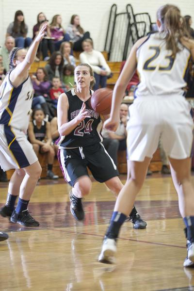 Farmington's Bridget Kelly looks for a shot against RHAM in the CCC tournament quarterfinals Monday at Farmington High School.
