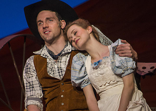 "Bryant Martin and Madison Claire Parks as Curly and Laurey in ""Oklahoma!"" at the Carpenter Center."