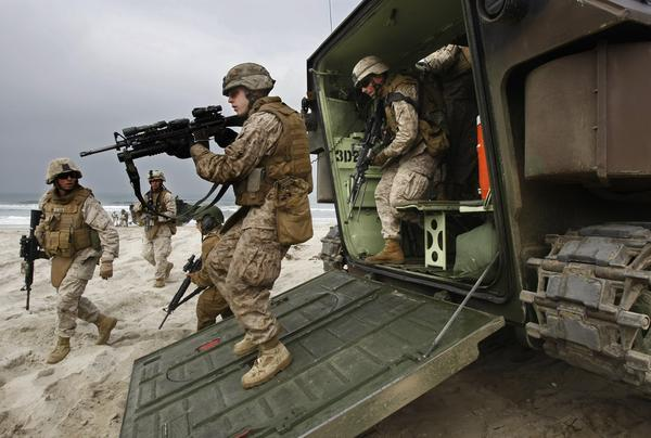 U.S. Marine Corps infantrymen from Camp Pendleton disembark from an amphibious assault vehicle after coming ashore.