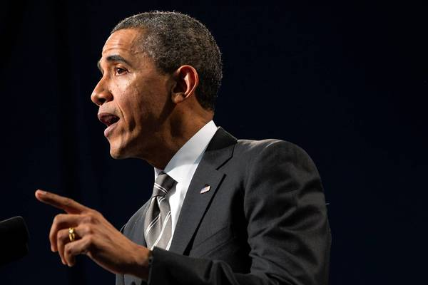 President Barack Obama speaks Friday at Hyde Park Academy about the importance of stable families and fatherhood in reducing violence.