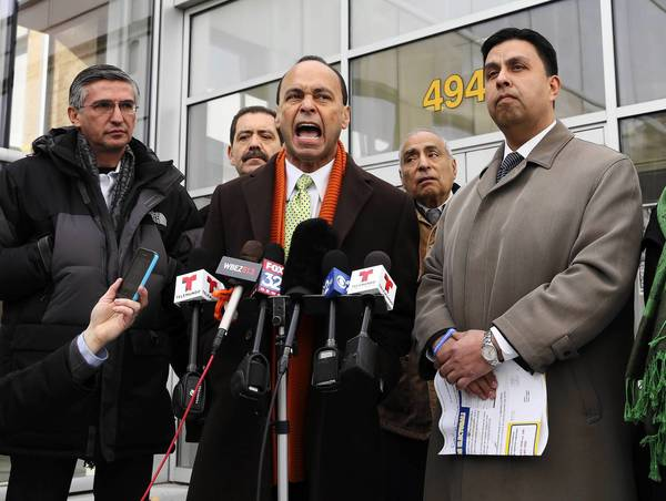 Rep. Luis Gutierrez, D.-Ill., called for an investigation into charges of harassment of Latino voters by Cicero Town President Larry Dominick and his supporters. At right is Juan Ochoa, who is running against Dominick.