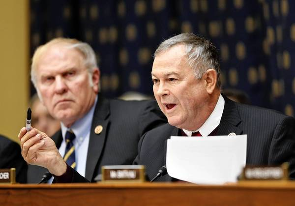 "Rep. Dana Rohrabacher, right, attends a session of the House Foreign Affairs Committee. ""Just because you are a wonderful person doesn't mean you deserve to be an American citizen,"" he said in an interview."