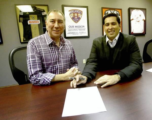 Investor Flavio Augusto Da Silva of Brazil, right, with president Phil Rawlins at the Orlando City Soccer offices. A multi-pronged deal that could give Orlando a Major League Soccer franchise and a new soccer stadium is reaching critical mass.