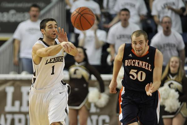 Lehigh's Anthony D'Orazio passes the rebound recovered ball. The Lehigh University Mountain Hawks played against the Bucknell University Bison in patriot league basketball Monday, February 18, 2013 at Stabler Arena on the campus of Lehigh University in Bethlehem.