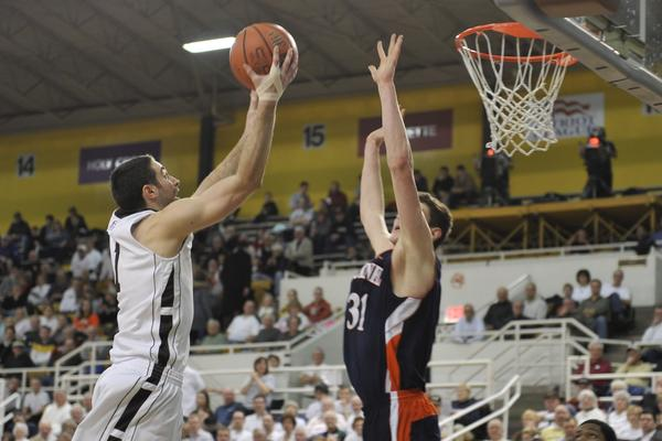 FRE Caption:     Lehigh's Anthony D'Orazio shoots for the basket at Bucknell's Mike Muscala attempts to block. The Lehigh University Mountain Hawks played against the Bucknell University Bison in patriot league basketball Monday, February 18, 2013 at Stabler Arena on the campus of Lehigh University in Bethlehem.