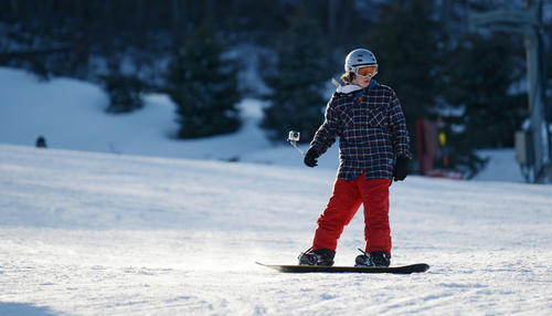 A snowboarder makes his way down the slopes at Bear Creek in Macungie on Monday. The resort was busy Monday because of the President's Day holiday.