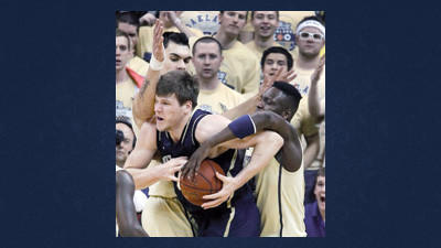 Notre Dame's Jack Cooley, center, is pressured by Pittsburgh's Steven Adams, left, and Talib Zanna, right, in the first half of an NCAA college basketball game on Monday in Pittsburgh.