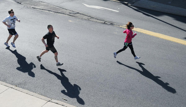 The shadows of runners stretch across West Church Street in Bethlehem as they make the turn off of Bridge Street through the streets of Bethlehem Saturday morning April 18, 2009 during the third annual YWCA 5k Race Against Racism. Approximately 140 runners and walkers participated in the YWCA of Bethlehem's third annual Race Against Racism 5k walk /run race held in Bethlehem.