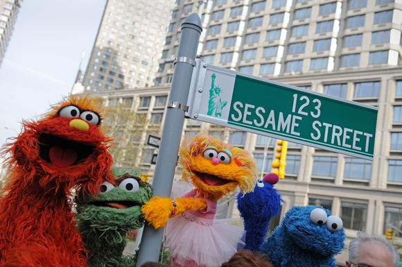 Sesame Street puppet charactors Murray (L), Oscar (2nd L), Zoe (2nd R) and Cookie Monster (R)