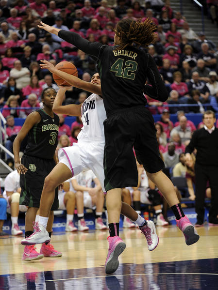 UConn guard Bria Hartley drives to the basket against Baylor center Brittney Griner but had her shot blocked in the second half at the XL Center Monday night. Hartley scored 13 points but had five turnovers as Griner scored 25 points and grabbed nine rebounds in a 76-70 Baylor victory.