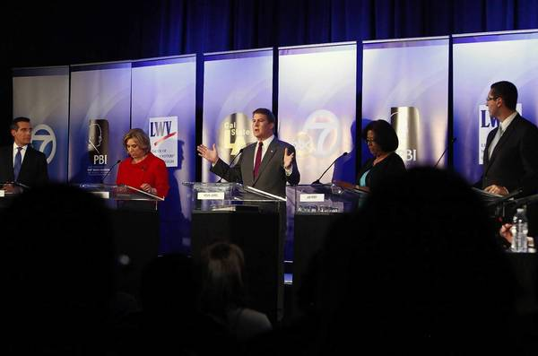 "Kevin James, center, speaks during a debate at Cal State L.A.'s Edmund G. ""Pat"" Brown Institute of Public Affairs. Also participating were, from left, Eric Garcetti, Wendy Greuel, Jan Perry and Emanuel Pleitez."