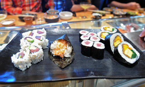 Different types of sushi rolls, made by professional chefs, are shown to students before they attempt to make one themselves.