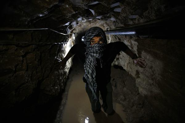 A Palestinian works inside a smuggling tunnel flooded by Egyptian forces, beneath the Egyptian-Gaza border in Rafah, in the southern Gaza Strip February 19, 2013. Egypt will not tolerate a two-way flow of smuggled arms with the Gaza Strip that is destabilizing its Sinai peninsula, a senior aide to its Islamist president said, explaining why Egyptian forces flooded sub-border tunnels last week.