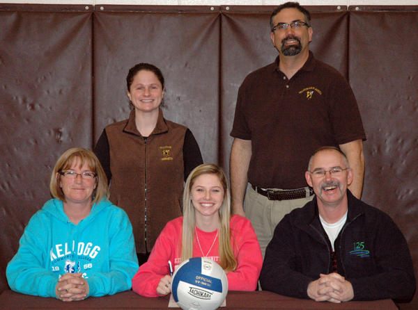 Pellston senior Victoria Rybinski (front, middle) signs a National Letter of Intent to play volleyball for Kellogg Community College Monday at the Pellston High School gym. Joining Rybinski at her signing is (from left) her mother, Janine Rybinski, Pellston volleyball coach Brooke Groff, Pellston athletic director Tony Basanese and father, Chris Rybinski.
