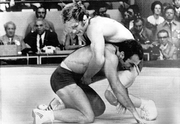 Dan Gable (top) in his final-round match with Soviet Ruslan Ashuraliev at the 1972 Olympics.