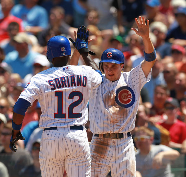 Alfonso Soriano and Tony Campana celebrate after scoring against Boston in a game last June at Wrigley Field.