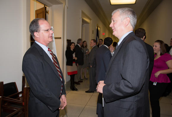 U.S. Rep. Brett Guthrie, left, and Jim Steiner, senior vice president of Corning Specialty Materials, talk last week outside a House subcommittee hearing where Steiner testified.