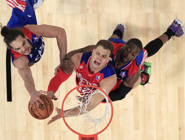 NBA All-Star Blake Griffin of the Los Angeles Clippers (C) is guarded by All-Star Dwyane Wade of the Miami Heat (R) and Joakim Noah of the Chicago Bulls (L) during the 2013 NBA All-Star basketball game in Houston, Texas.