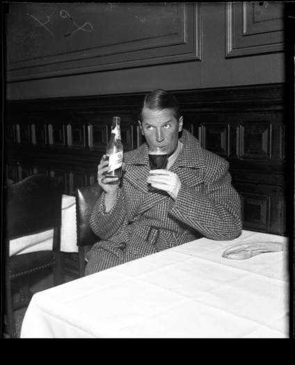 Actor Maurice Chevalier drinks a Pabst Blue Ribbon beer at a Chicago bar, March 24, 1933.