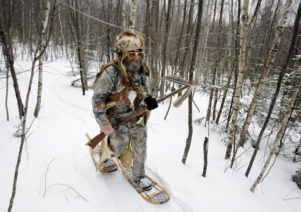 Kenny Gaudette makes his way to the next shooting station as he competes in the Primitive Biathlon in Dalton, N.H. The Dalton Gang, a single action shooting club, holds the annual Primitive Biathlon in which competitors wear snowshoes and fire single shot muzzle loaded firearms at four stations along a 1.75 mile course.