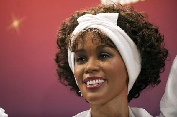 One of four wax figures of deceased singer Whitney Houston sits on display after being unveiled at Madame Tussauds Wax Museum in New York.