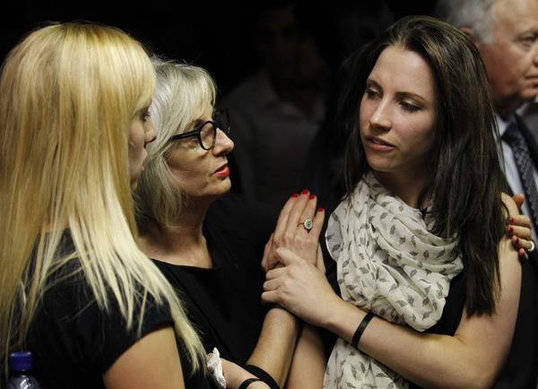 Oscar Pistorius's sister Aimee, right, is consoled by relatives at the end of her brother's court appearance in the Pretoria Magistrates court Feb. 19, 2013.
