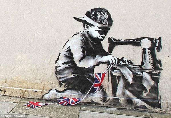 'Banksy Slave Labor (Bunting Boy). London 2012'