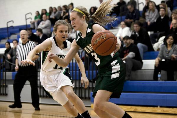 New Trier junior Alexa Czyzynski, 11, guards Lane senior Jackie Bynes, 3, during the second quarter at Mather High School on Feb. 13