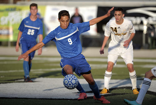 West Orange's Carlos Barragan controls the ball in the middle of the field during the second half of their state finals game against Cypress Bay, Saturday, February 16, 2013, at Melbourne High School. Cypress Bay won 1-0.