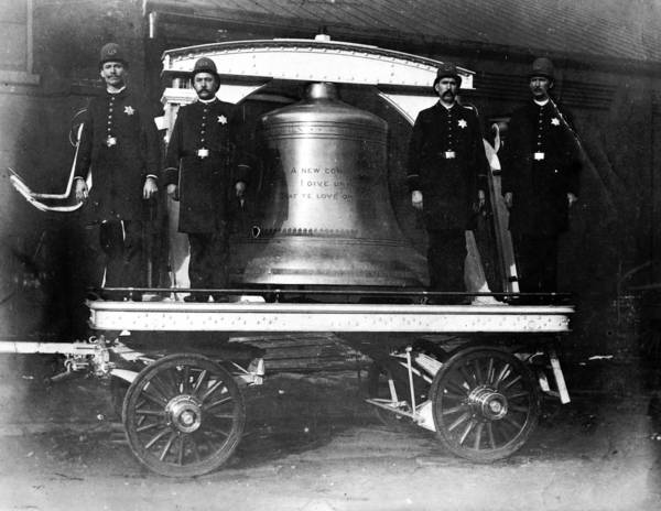 Chicago police guard the Liberty Bell. An extension of the bell's famous crack was discovered while in Chicago and may have been caused while traveling by rail.
