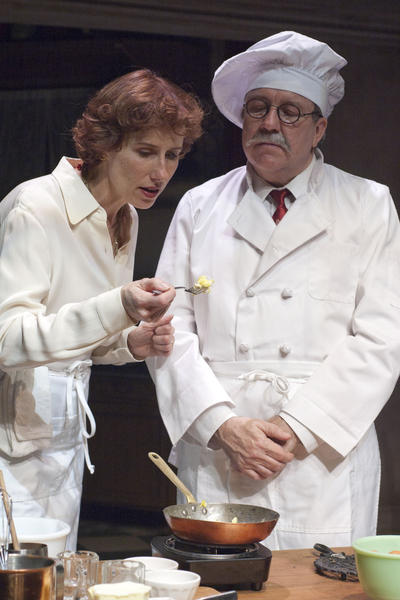 "Julia Child (Karen Janes Woditsch, left) is schooled in the delicate art of cooking scrambled eggs by Le Cordon Bleu instructor Chef Max Bugnard (Terry Hamilton) in France in the 1950s in the 2010 production of "" To Master the Art"" at TimeLine Theatre."