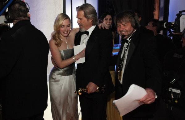 "Dency Nelson shows the way offstage to Jeff Bridges, clutching his lead actor Oscar (for ""Crazy Heart"") just presented to him by Kate Winslet at the 82nd Academy Awards in 2010."