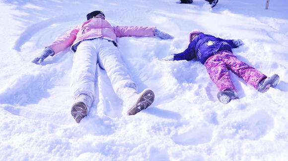 Katie and Raygen Drzewiecki create snow angels.