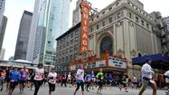 A Chicago Marathon official said Tuesday that registration for the October event will not reopen until at least Thursday after website woes caused registration to be temporarily suspended.