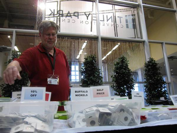 Richard Quitmeyer of Minneapolis-based Yellow River Rare Coins shops his wares at the Greater Chicago Coin Currency & Collectible Show at the Tinley Park Convention Center on Thursday , Feb. 14, 2013.