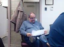 Tinley Park mayoral candidate Stephen Eberhardt reads through handouts at the Committee of the Whole meeting Tuesday, Feb. 12, at which Village Clerk Pat Rea singled him out as the man behind costly public information requests.