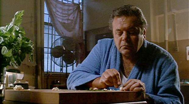 """Goodfellas"" (1990). Best dude cooking scene ever. The ballet of a group of friends making food together is captured in loving detail in total counterpoint to the tough guy dialogue delivered in rough voices. Slicing garlic with a razor blade is a classic."