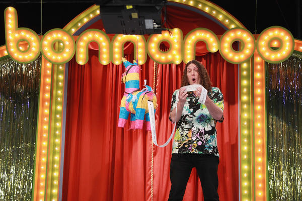 Comedian 'Weird Al' Yankovic receives the lineup from Roo-pert the Lineup Announcing Donkey during the 2013 Bonnaroo Lineup Announcement Megathon.