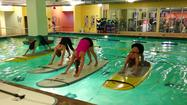 Paddle board yoga became a big craze in the last few years, but the class was limited to the summer months when it was warm.