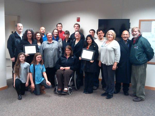 Recipients of Mundelein's annual Diversity Award pose with supporters and organizers of the award at the town's board meeting Feb. 11.