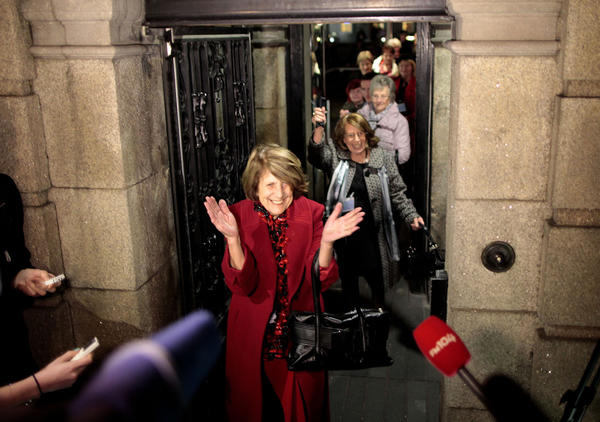 Kathleen Janette, who worked at the Catholic-run workhouses known as the Magdalen laundries, reacts along with other women after leaving the Irish Parliament building in Dublin on Tuesday.