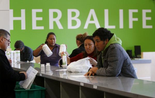 Herbalife distributors pick up product at a warehouse in Carson.