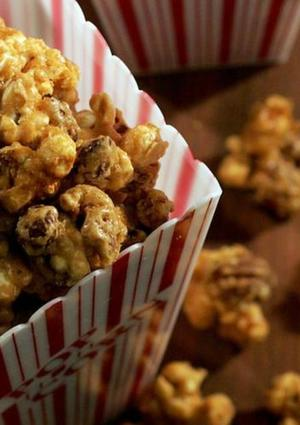 "The movie experience simply isn't complete without popcorn. But why stop at plain popcorn when you can coat it in rich caramel and nuts? Better fix an extra batch -- this stuff'll go quickly. <a href=""http://www.latimes.com/features/la-fo-popcorn20recafeb20,0,5878803.story"">Click here for the recipe.</a>"