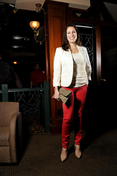 "Monica Baker, 41, lived up to the theme of the Havana Club's Salsa Night Valentine's Day: Lady in Red. The Medfield resident was red-hot in scarlet Puzzle jeans from ideeli.com, a white sequined Express tank and a white cotton Gap boyfriend jacket. The Group Benefits Services sales coordinator found her nude pointy toe BCBG pumps at Marshalls, her leopard print raffia envelope clutch at Laila Rowe, and her gold hoop earrings at New York & Co. She said she's had her red Gucci bracelet watch for 20 years. Baker said she loves lots of color in what she calls her ""trendy"" style. ""But, I neutralize it somehow,"" she said. She checks out fashion blogs like jseverydayfashion.com and pennypincherfashion.com to get outfit ideas. Baker is currently loving colored skinny jeans, as well as leopard prints. ""I feel like leopard is the new neutral,"" she said."