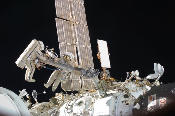 Russian cosmonauts Oleg Kononenko, left, and Anton Shkaplerov, both Expedition 30 flight engineers, participate in a session of extravehicular activity to continue outfitting the International Space Station.