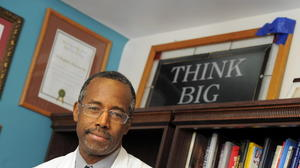 Would Ben Carson approve cutting research at Hopkins to balance the federal budget?