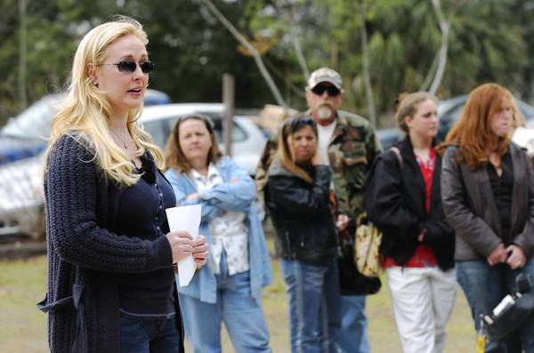 Country singer Mindy McCready delivered 15 sets of car keys to tornado victims on behalf of 1-800-Charity Cars during a presentation at the First Baptist Church of Paisley in 2007.
